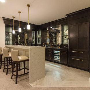 Large modern breakfast bar in DC Metro with a submerged sink, freestanding cabinets, dark wood cabinets, marble worktops, glass tiled splashback, porcelain flooring, white floors and beige worktops.