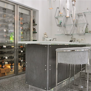 Seated home bar - large modern l-shaped ceramic floor seated home bar idea in Other with an undermount sink, flat-panel cabinets, gray cabinets and recycled glass countertops