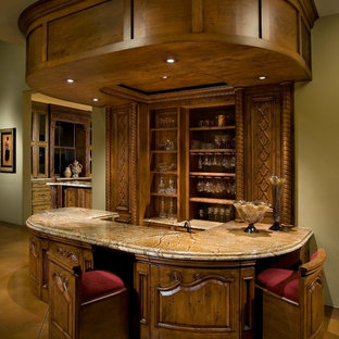 Victorian galley breakfast bar in Orange County with marble worktops, concrete flooring, brown floors and dark wood cabinets.