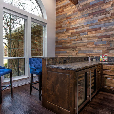 Mid-sized mountain style u-shaped dark wood floor and brown floor seated home bar photo in Dallas with raised-panel cabinets, dark wood cabinets, granite countertops and black countertops