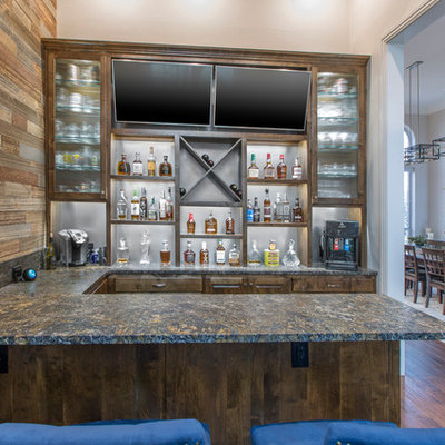 Seated home bar - mid-sized rustic u-shaped dark wood floor and brown floor seated home bar idea in Dallas with raised-panel cabinets, dark wood cabinets, granite countertops and black countertops