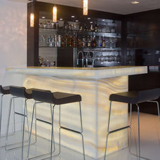 Contemporary Home Bar by Umber Architecture, LLC