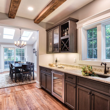 Open Concept Butler's Pantry With a Dining Room View