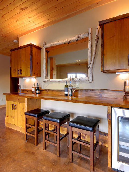 inspiration for a mid sized rustic single wall seated home bar remodel