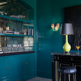 This is an example of a medium sized traditional single-wall home bar in San Francisco with recessed-panel cabinets, blue cabinets, marble worktops, white splashback, carpet, grey floors and black worktops.