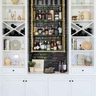 Inspiration for a beach style single-wall home bar in Los Angeles with no sink, open cabinets, white cabinets, black splashback, dark hardwood flooring, brown floors and white worktops.