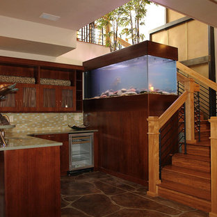 Photo of a large contemporary l-shaped breakfast bar in Denver with recessed-panel cabinets, dark wood cabinets, engineered stone countertops, multi-coloured splashback, mosaic tiled splashback, slate flooring, brown floors and green worktops.