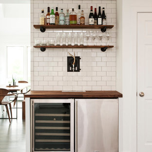 Example Of A Small Trendy Single Wall Home Bar Design In New York With Wood
