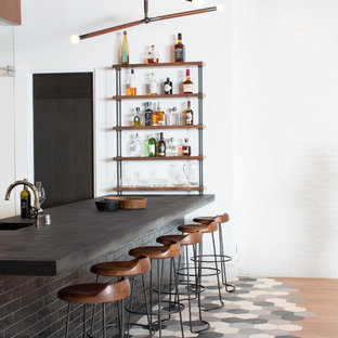 Home bar - transitional multicolored floor home bar idea in Orange County