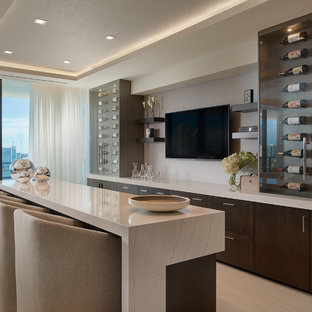 Inspiration for a contemporary galley white floor home bar remodel in Miami with flat-panel cabinets, dark wood cabinets, gray backsplash and white countertops