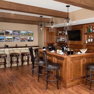 Seated home bar - large craftsman l-shaped medium tone wood floor seated home bar idea in New York with an undermount sink, recessed-panel cabinets, medium tone wood cabinets, wood countertops, brown backsplash and wood backsplash