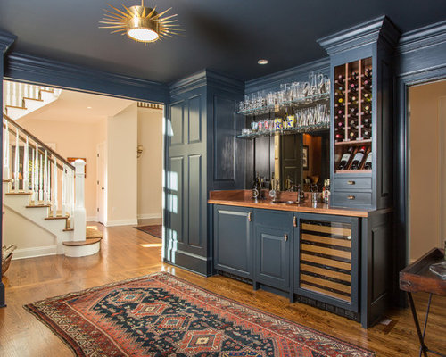 Example Of A Country Single Wall Dark Wood Floor Wet Bar Design In New York