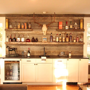 Design ideas for a small traditional single-wall wet bar in Other with a submerged sink, recessed-panel cabinets, white cabinets, granite worktops, grey splashback, wood splashback, medium hardwood flooring and brown floors.