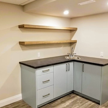 Refinished Basement with Baby Blue Walk-Up Bar