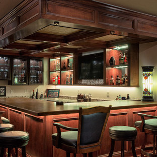 Seated home bar - large traditional u-shaped medium tone wood floor and brown floor seated home bar idea in Columbus with open cabinets, dark wood cabinets, wood countertops and brown countertops