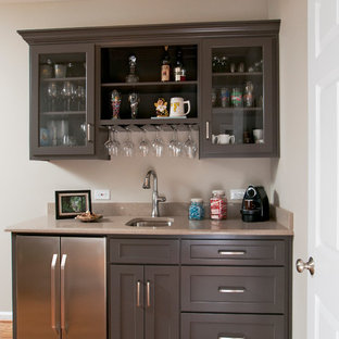 Design ideas for a small traditional single-wall wet bar in Atlanta with a submerged sink, recessed-panel cabinets, grey cabinets, marble worktops and medium hardwood flooring.