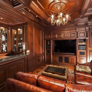 Immagine di un grande bancone bar chic con lavello sottopiano, ante di vetro, ante in legno scuro, top in granito, pavimento in laminato, pavimento giallo e top grigio
