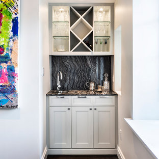 Design ideas for a small traditional single-wall wet bar in New York with shaker cabinets, white cabinets, dark hardwood flooring, a submerged sink, granite worktops, black splashback and stone slab splashback.