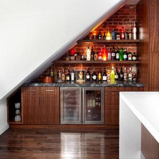 Medium sized contemporary single-wall home bar in Toronto with flat-panel cabinets, dark wood cabinets, marble worktops, dark hardwood flooring, brick splashback and red splashback.