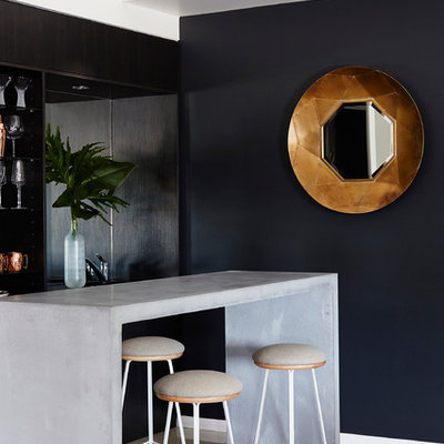 Trendy galley seated home bar photo in Other with open cabinets, black cabinets and concrete countertops