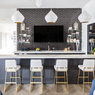 Inspiration For A Huge Mediterranean Light Wood Floor And Beige Seated Home Bar Remodel In