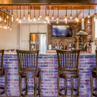 Photo of a large rustic u-shaped breakfast bar in Detroit with recessed-panel cabinets, white cabinets, engineered stone countertops, red splashback, brick splashback and brown worktops.