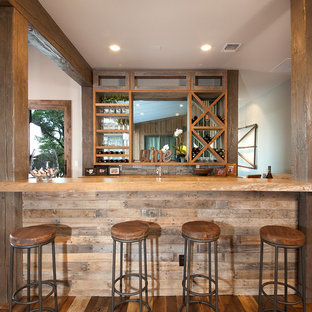 Seated home bar - large rustic single-wall medium tone wood floor and brown floor seated home bar idea in Austin with open cabinets, medium tone wood cabinets, wood countertops and beige countertops