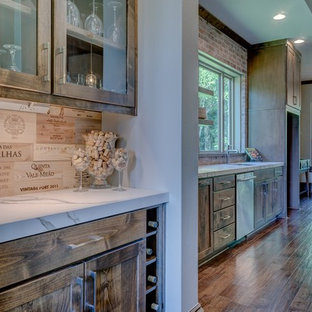 Photo of a medium sized rustic single-wall home bar in Indianapolis with shaker cabinets, medium wood cabinets, marble worktops, wood splashback and medium hardwood flooring.