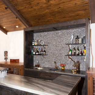 This is an example of a medium sized rustic galley wet bar in Los Angeles with a submerged sink, flat-panel cabinets, dark wood cabinets, marble worktops, brown splashback, marble splashback, medium hardwood flooring, brown floors and brown worktops.