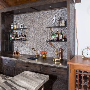Medium sized rustic galley wet bar in Los Angeles with a submerged sink, flat-panel cabinets, dark wood cabinets, marble worktops, brown splashback, marble splashback, medium hardwood flooring, brown floors and brown worktops.