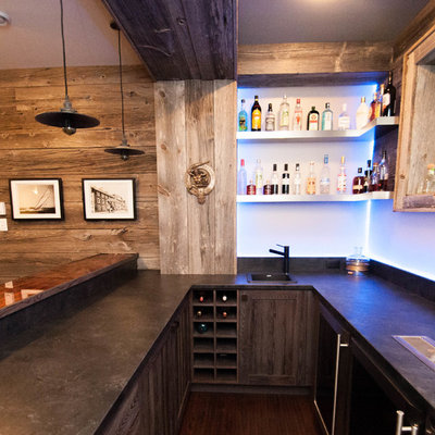 Inspiration for a large rustic u-shaped dark wood floor and brown floor seated home bar remodel in Other with a drop-in sink, shaker cabinets, light wood cabinets, concrete countertops, blue backsplash and glass sheet backsplash