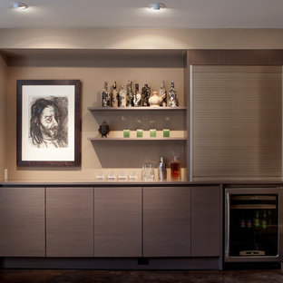 Inspiration for a huge contemporary single-wall concrete floor wet bar remodel in San Francisco with flat-panel cabinets, gray cabinets, solid surface countertops and brown backsplash
