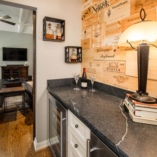 Design ideas for a small classic single-wall home bar in Dallas with shaker cabinets, white cabinets, soapstone worktops, brown splashback and medium hardwood flooring.