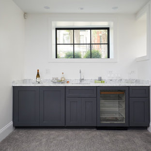 Design ideas for a classic home bar in Chicago with a submerged sink, shaker cabinets, grey cabinets, marble worktops, grey splashback, marble splashback, carpet, beige floors and grey worktops.