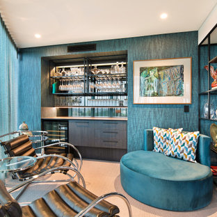 Photo of a contemporary single-wall home bar in Sunshine Coast with no sink, flat-panel cabinets, dark wood cabinets, mirror splashback, carpet, beige floor and beige benchtop.