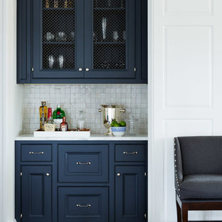 Inspiration for a small victorian single-wall home bar in Jacksonville with no sink, recessed-panel cabinets, blue cabinets, white splashback, mosaic tile splashback, dark hardwood floors and white benchtop.