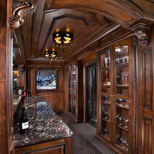 This is an example of an expansive traditional galley wet bar in Phoenix with a submerged sink, raised-panel cabinets, brown cabinets, marble worktops, marble flooring and multi-coloured floors.