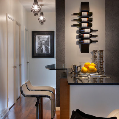 Seated home bar - contemporary dark wood floor seated home bar idea in Toronto with a drop-in sink