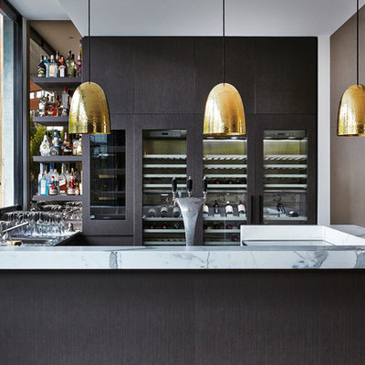 Example of a trendy u-shaped dark wood floor home bar design in Melbourne with flat-panel cabinets, dark wood cabinets and marble countertops