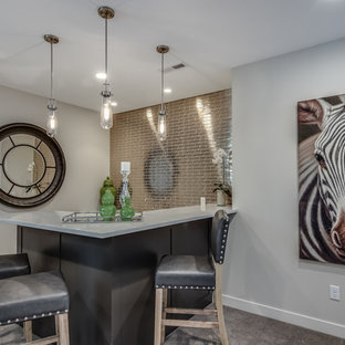Example of a mid-sized urban l-shaped carpeted and gray floor seated home bar design in Minneapolis with marble countertops, brown backsplash and metal backsplash