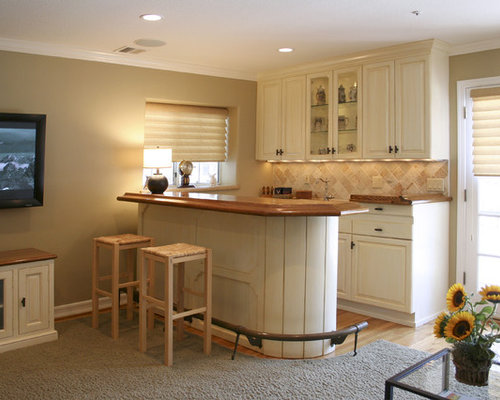 inspiration for a rustic home bar remodel in los angeles with carpet and beige backsplash