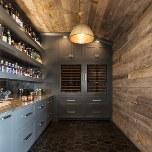 Inspiration for a mid-sized transitional single-wall home bar in Austin with grey cabinets, black floor, shaker cabinets, granite benchtops, multi-coloured splashback and mirror splashback.