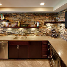 Modern Basement by Design First  Builders