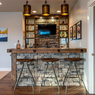 Wet bar - rustic galley medium tone wood floor and brown floor wet bar idea in Other with open cabinets, wood countertops, gray backsplash, stone tile backsplash and brown countertops