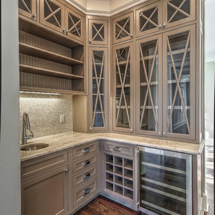 Transitional l-shaped medium tone wood floor wet bar photo in New York with an undermount sink, shaker cabinets, beige cabinets, quartzite countertops, beige backsplash and ceramic backsplash