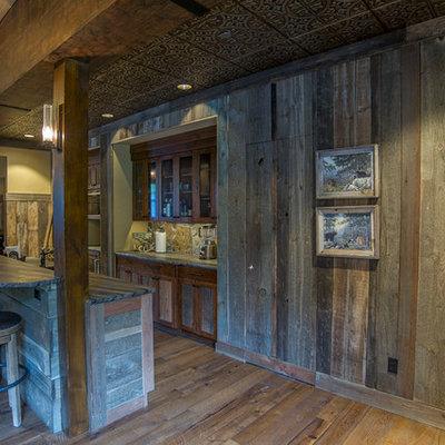 Inspiration for a rustic single-wall seated home bar remodel in Seattle with dark wood cabinets
