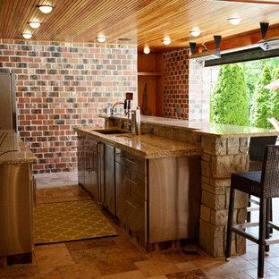 Foto di un grande bancone bar chic con lavello sottopiano, ante lisce, ante grigie, top in granito e pavimento in cemento
