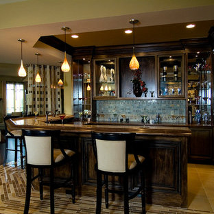 Inspiration for a mid-sized timeless l-shaped ceramic floor and beige floor seated home bar remodel in Chicago with raised-panel cabinets, dark wood cabinets, wood countertops, blue backsplash, ceramic backsplash and brown countertops