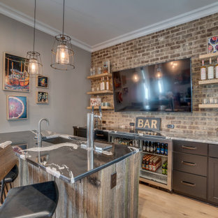 Country galley breakfast bar in Richmond with a built-in sink, shaker cabinets, black cabinets, marble worktops, brick splashback, light hardwood flooring and black worktops.