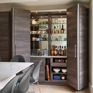 Design ideas for a small contemporary single-wall home bar in Berkshire with no sink, flat-panel cabinets, dark wood cabinets, mirror splashback, beige floors and white worktops.